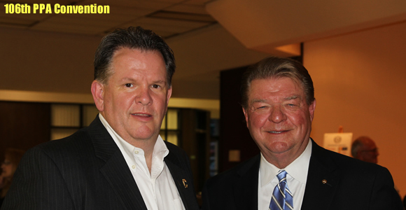 Clarendon College President Robert Riza with Happy State Bank President J. Pat Hickman.